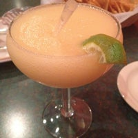 Photo taken at Arriba Mexican Restaurant & Lounge by Clarice M. on 4/30/2013