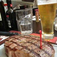 Photo taken at Roadhouse Grill by Cristina U. on 7/20/2013