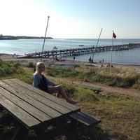 Photo taken at Ordrup Strand by Jakob W. on 7/17/2013