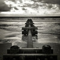 Photo taken at 13th St. Beach by Jason S. on 9/17/2014