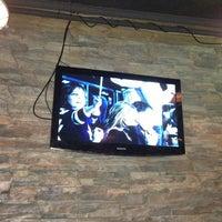 Photo taken at Lou Dawg's B-B-Q! by ILYA S. on 5/12/2013