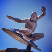Photo taken at Kelly Slater Statue by Paige on 3/5/2013