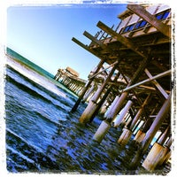 Photo taken at Cocoa Beach Pier by Paige on 3/6/2013