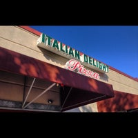 Photo taken at Italian Delight Pizzeria by Paige on 11/19/2012
