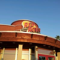 Photo taken at Red Robin Gourmet Burgers by A S. on 3/14/2014
