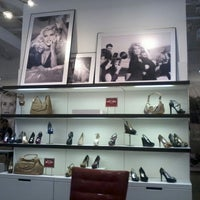 Photo taken at GUESS Factory Store by Marcos F. on 9/15/2012
