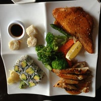Photo taken at TJ Asian Bistro by Stephanie A. on 7/27/2013