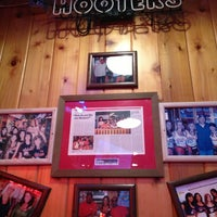Photo taken at Hooters by Mariko del Rosario on 7/25/2013