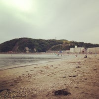 Photo taken at Zushi Beach by kenta n. on 6/1/2013