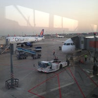 Photo taken at Gate 111 by Bülent KAYA on 7/27/2013