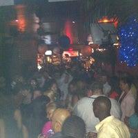 Photo taken at Tropix Bar & Lounge by Dan T. on 9/16/2012