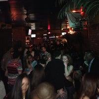 Photo taken at Tropix Bar & Lounge by Dan T. on 3/16/2013