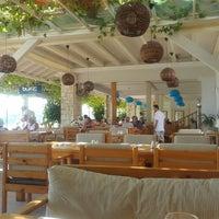 Photo taken at Buzz Beach Bar by Fethiye H. on 9/22/2013