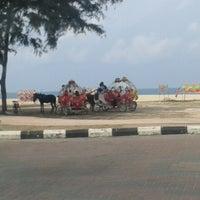 Photo taken at Batu burok beach by anthony b. on 5/30/2014