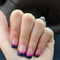 Photo taken at World Nails by Brooke L. on 9/11/2014