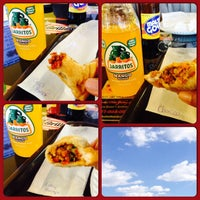 Photo taken at Island Empanada by Sandy Q. on 3/18/2014