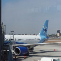 Photo taken at Gate 12 by Arthur C. on 8/20/2013