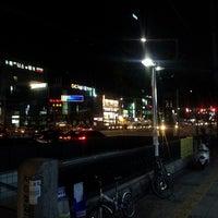 Photo taken at 군자역사거리 by 재희Jay 홍. on 10/1/2013