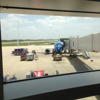 Photo taken at Gate 129 by Paul B. on 8/11/2013