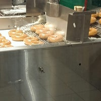 Photo taken at Krispy Kreme Doughnuts by Russ C. on 10/13/2013