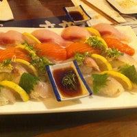 Photo taken at Sushi Zone by David K. on 7/16/2013