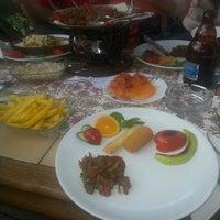 Photo taken at mumin's garden by Neşe A. on 4/12/2013