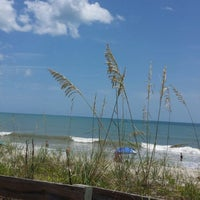Photo taken at The Beach Behind Sun On The Beach by Gina V. on 7/4/2014
