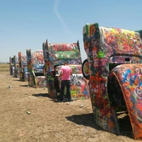 Photo taken at Cadillac Ranch by Louis H. on 6/27/2013