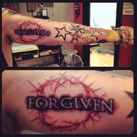 Photo taken at Iron Rose Tattoos by Iron Rose Tattoos on 12/6/2012