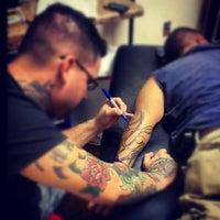 Photo taken at Iron Rose Tattoos by Iron Rose Tattoos on 10/19/2012