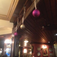 Photo taken at Fuller's Ale & Pie House by Irina B. on 1/1/2014
