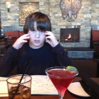 Photo taken at Firebirds Wood Fired Grill by Christine S. on 10/14/2012
