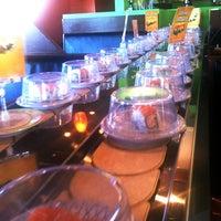 Photo taken at Kura Sushi by Adri C. on 12/11/2012