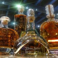 Photo taken at Bacchus Liquors by Juan Carlos D. on 2/25/2015
