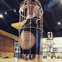 Photo taken at Bacchus Liquors by Juan Carlos D. on 2/2/2015