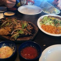 Photo taken at Milagros by Kerry M. on 10/15/2012