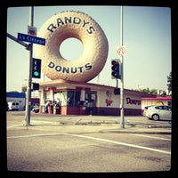 Photo taken at Randy's Donuts by Ross on 12/8/2012