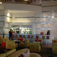 Photo taken at Radisson Blu Lobby Bar by Riaz M. on 1/27/2013