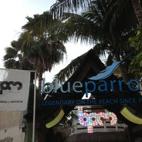 Photo taken at The Blue Parrot Beach Club by Hector C. on 1/11/2013