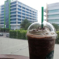 Photo taken at Starbucks Coffee by JaVee F. on 7/25/2013