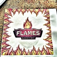 Photo taken at Flames Eatery & Bar by Nando G. on 4/14/2013