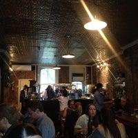 Photo taken at Iris Cafe by Raphael 5. on 7/13/2013
