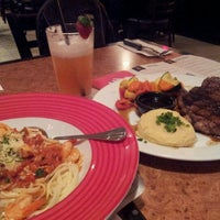Photo taken at T.G.I. Friday's by Nurul N. on 3/12/2013