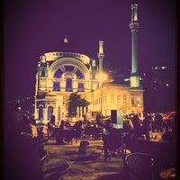 Photo taken at Dolmabahçe Çay Bahçesi by Enis E. on 5/9/2013