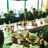 Photo taken at D'Mangu Restaurant by Kelly M. on 2/19/2013