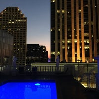 Photo taken at Le Pavillon rooftop pool by Warren C. on 7/29/2015