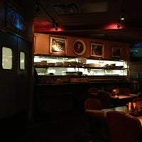 Photo taken at Paymon's Mediterranean Cafe & Hookah Lounge by Wally S. on 1/28/2013