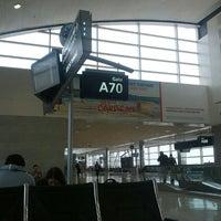 Photo taken at Gate A70 by Alexis L. on 9/15/2013