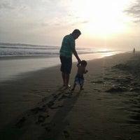 Photo taken at Playa La Punta by Gamisho O. on 2/27/2013