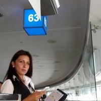 Photo taken at Gate 63 by Zeynep Ş. on 6/24/2014